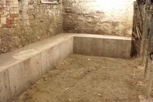 Adding height to your basement underpinning or benching for Building a basement foundation